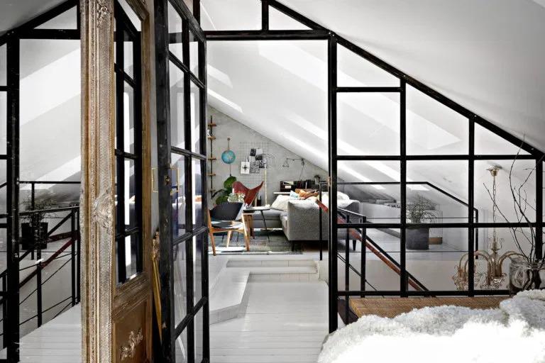 dvoetažni stan u potkrovlju uređen u industrijskom stilu